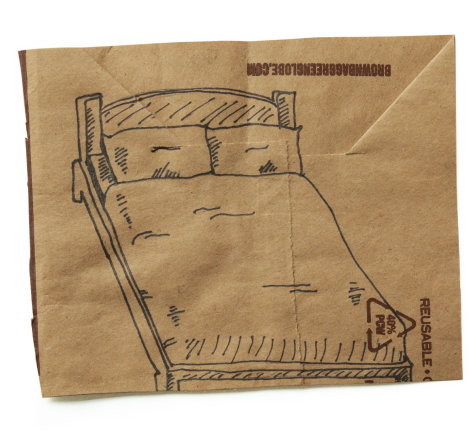Ink drawing of a bed on a square of brown paper centered on a white background