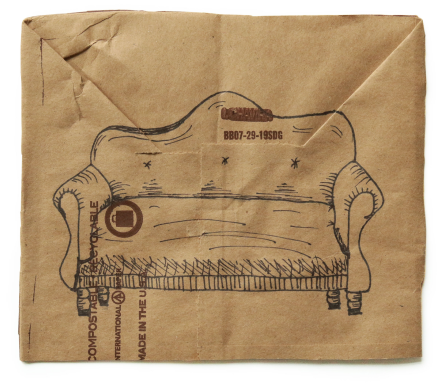 Ink drawing of a sofa on a square of brown paper centered on a white background
